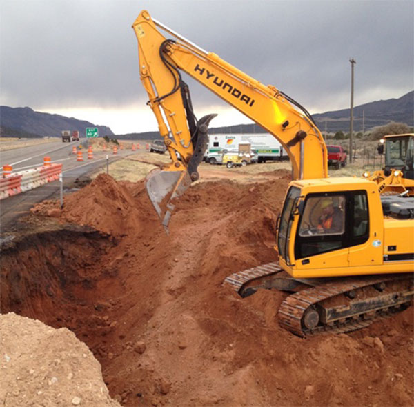 Track hoe excavating Cedar City